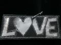 Love (heijastinkangasta ja nahkaa)